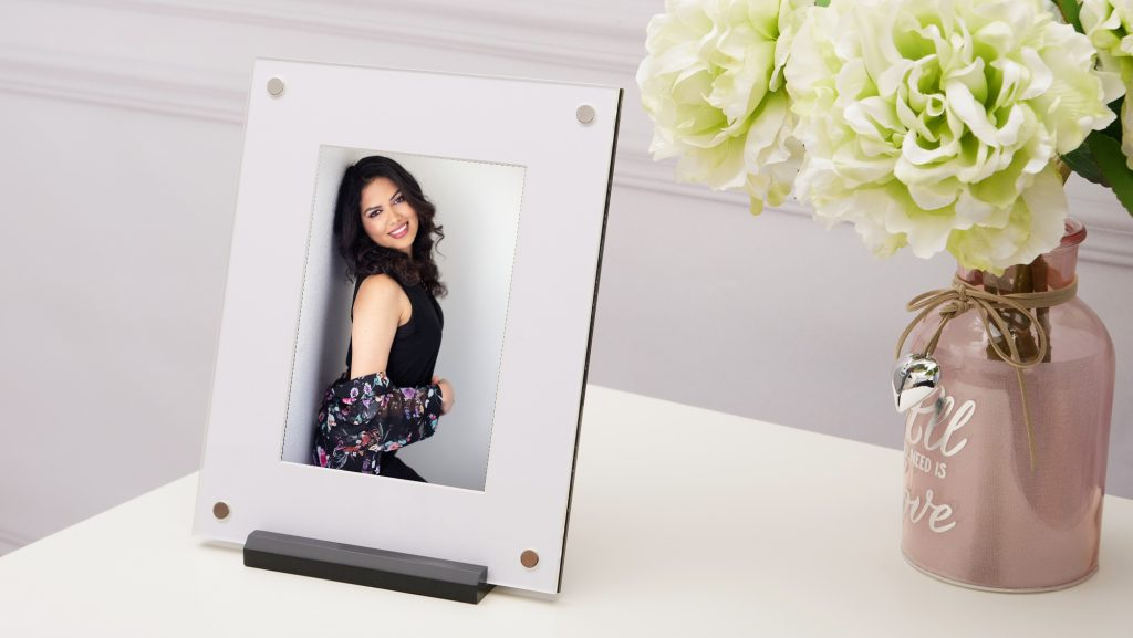 Back to YOU special! My special includes this modern 8x10 Folio Art Frame by 3XM. The image in the frame is a beauty photo of an Indian woman posing against a wall with a white background. For more info, visit byRayleigh.com