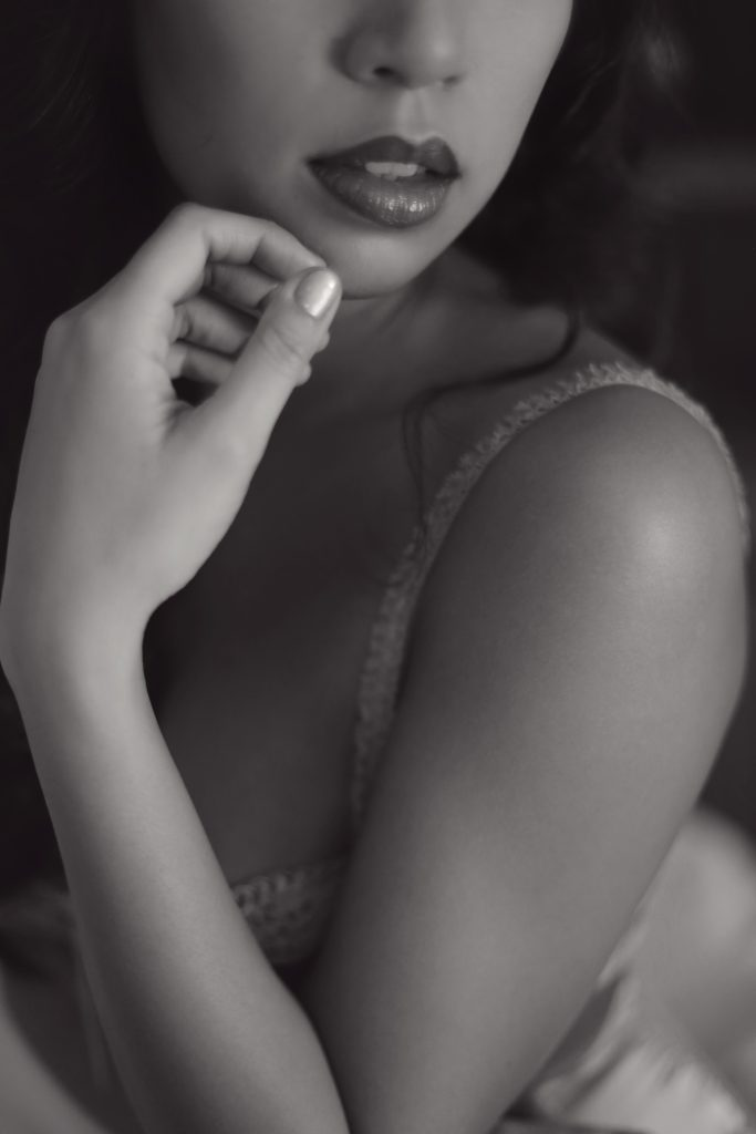 Should a Christian woman do a boudoir shoot? This tightly cropped black and white modest boudoir photo of an Asian girl accentuates the lips. This photo was created by Photography by Rayleigh. For more info, please visit byrayleigh.com.